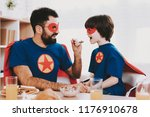 young family in superhero suits.... | Shutterstock . vector #1176910678