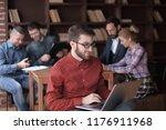 designer working on a laptop in ...   Shutterstock . vector #1176911968