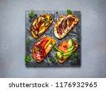 set of assorted bruschetta ... | Shutterstock . vector #1176932965