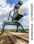 giant  green cargo crane on... | Shutterstock . vector #1176942655