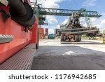 two red forklifts in container... | Shutterstock . vector #1176942685
