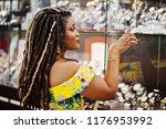cute small height african... | Shutterstock . vector #1176953992