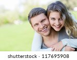 happy young couple outdoors | Shutterstock . vector #117695908