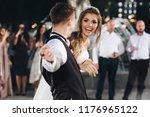 bride and groom dance with... | Shutterstock . vector #1176965122