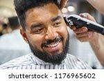 portrait of happy young black... | Shutterstock . vector #1176965602