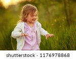 girl at sunset playing in the... | Shutterstock . vector #1176978868