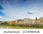 arno river at sunny day ... | Shutterstock . vector #1176980428