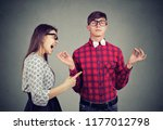 young woman in anger yelling at ... | Shutterstock . vector #1177012798