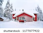 Red Wooden Cottage In A Snow...