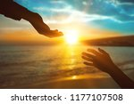 help hand on sunset background | Shutterstock . vector #1177107508