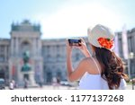 tourist girl taking picture or... | Shutterstock . vector #1177137268