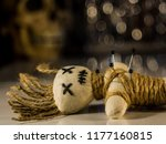 a needle punched doll lies on a ... | Shutterstock . vector #1177160815