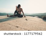 woman doing yoga on the top of... | Shutterstock . vector #1177179562