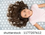 girl child with long curly hair ... | Shutterstock . vector #1177207612