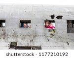 two female travelers greeting... | Shutterstock . vector #1177210192