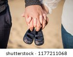 pregnant woman and man holding... | Shutterstock . vector #1177211068