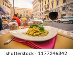 glass of red wine served with... | Shutterstock . vector #1177246342