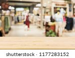 empty wood table with woman...   Shutterstock . vector #1177283152