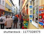 tourists window shopping on 22... | Shutterstock . vector #1177328575