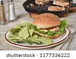 a fresh cooked tuna burger with ... | Shutterstock . vector #1177336222