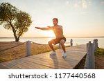 fitness man training air squat... | Shutterstock . vector #1177440568