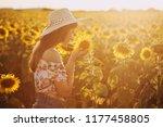 cute brunette in a blossoming... | Shutterstock . vector #1177458805