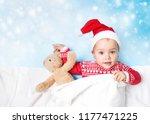 caucasian baby in santa hat... | Shutterstock . vector #1177471225