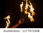 tools of a fire performer in... | Shutterstock . vector #1177472308