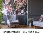 grey armchair against flowers... | Shutterstock . vector #1177555162
