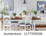 white chairs at wooden table... | Shutterstock . vector #1177559038