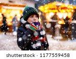 little cute kid boy drinking...   Shutterstock . vector #1177559458