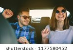 young couple smiling and... | Shutterstock . vector #1177580452