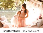pregnant mother holding kid... | Shutterstock . vector #1177612675