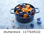 cast iron pot full of plums... | Shutterstock . vector #1177634122