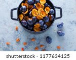 cast iron pot full of plums... | Shutterstock . vector #1177634125