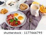breakfast with fried eggs ... | Shutterstock . vector #1177666795