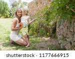 mother and son in holiday villa ... | Shutterstock . vector #1177666915