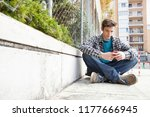 attractive teenager young man... | Shutterstock . vector #1177666945