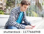 attractive teenager young man... | Shutterstock . vector #1177666948