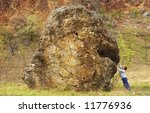 a boy is supporting a rock with ... | Shutterstock . vector #11776936
