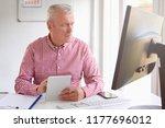 senior sales manager using... | Shutterstock . vector #1177696012
