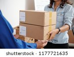 young postwoman giving package... | Shutterstock . vector #1177721635