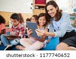 teacher and girl in elementary... | Shutterstock . vector #1177740652