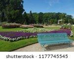 the public bench in a garden in ... | Shutterstock . vector #1177745545