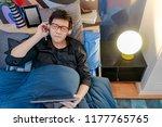 young asian happy man listening ...   Shutterstock . vector #1177765765