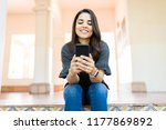 confident female chatting on... | Shutterstock . vector #1177869892