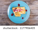 pancakes served with cream and... | Shutterstock . vector #1177906405
