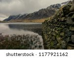 stone wall leading to a...