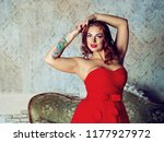 beautiful young woman with rose ... | Shutterstock . vector #1177927972