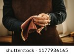 hands of female jeweler... | Shutterstock . vector #1177936165